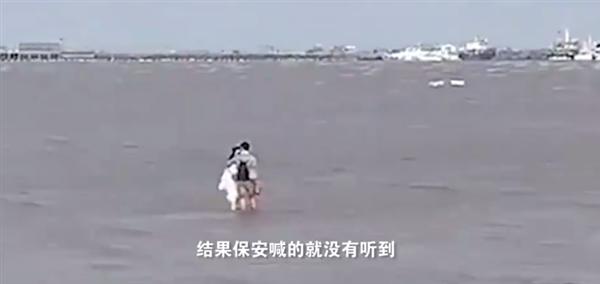【速搜资讯】情侣沙滩边亲热不知涨潮 急坏众人:保安狂喊别亲涨潮了